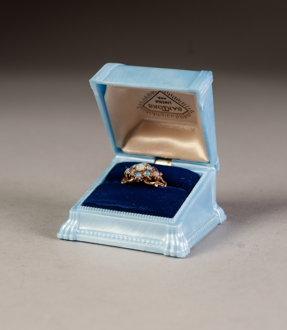 Lot 133 - 9ct GOLD DRESS RING SET WITH NINE TINY OPALS, 3.6 gms gross