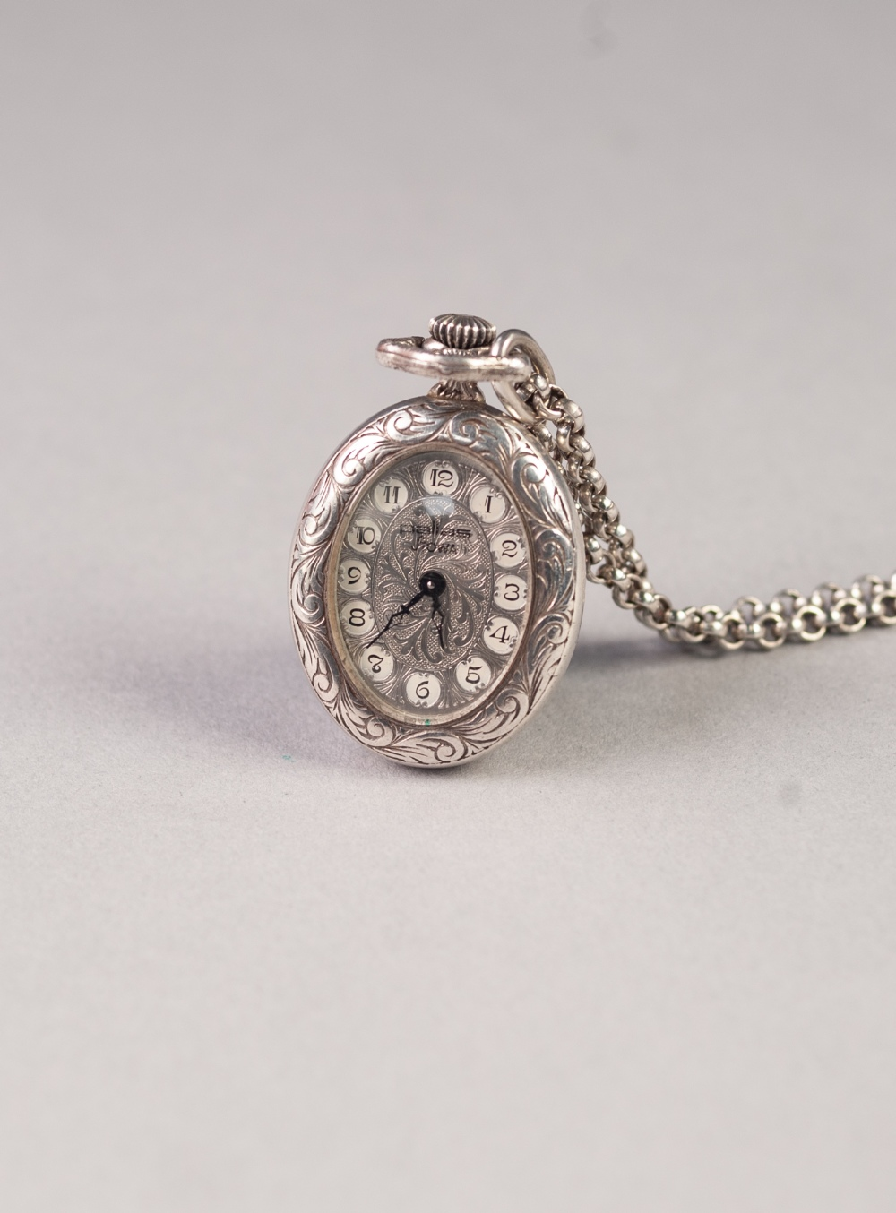 Lot 24 - PALLASS, STOWA, SILVER OVAL PENDANT WATCH, with mechanical movement, engine turned Arabic oval dial,