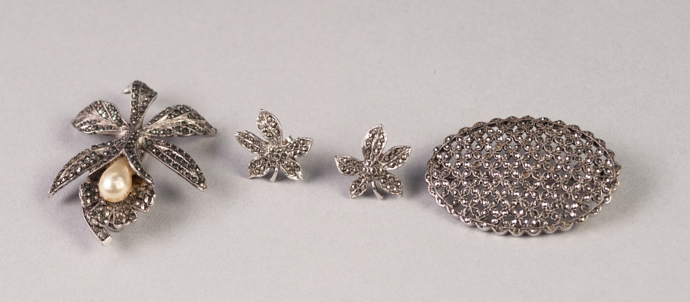 Lot 164 - SILVER AND MARCASITE ORCHID BROOCH, set with a tear shaped imitation pearl; a silver and marcasite