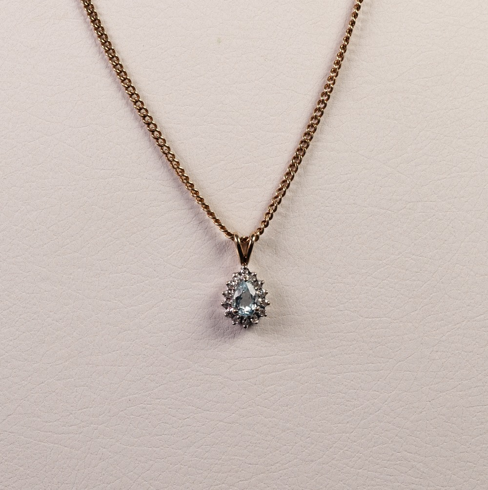 Lot 176 - SMALL WHITE GOLD PENDANT, set with a tear shaped zircon and surround of 14 tiny diamonds, yellow