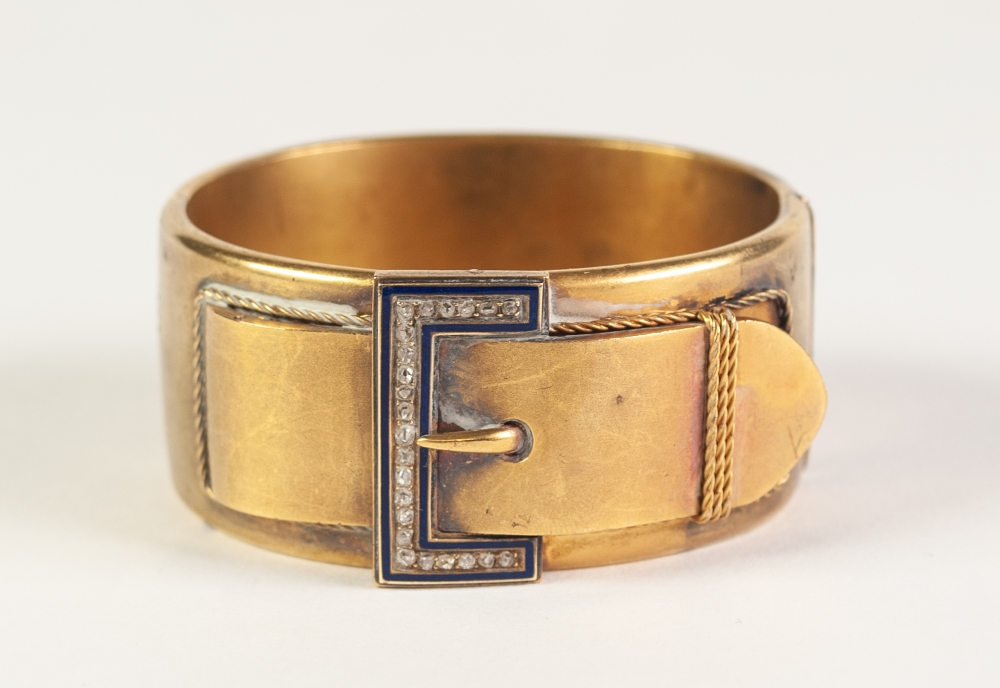 VICTORIAN GOLD COLOURED METAL HINGE OPENING BUCKLE BANGLE, 'buckle' top set with twenty three rose