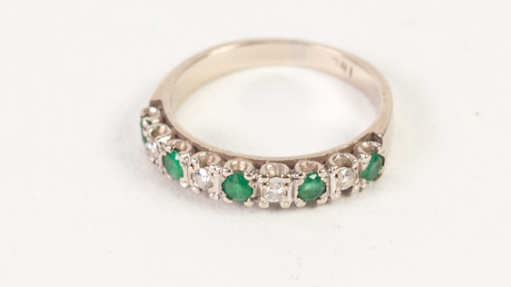 Lot 124 - AN 18ct WHITE GOLD TINY DIAMOND AND EMERALD SET HALF HOOP RING, 3.7gms gross