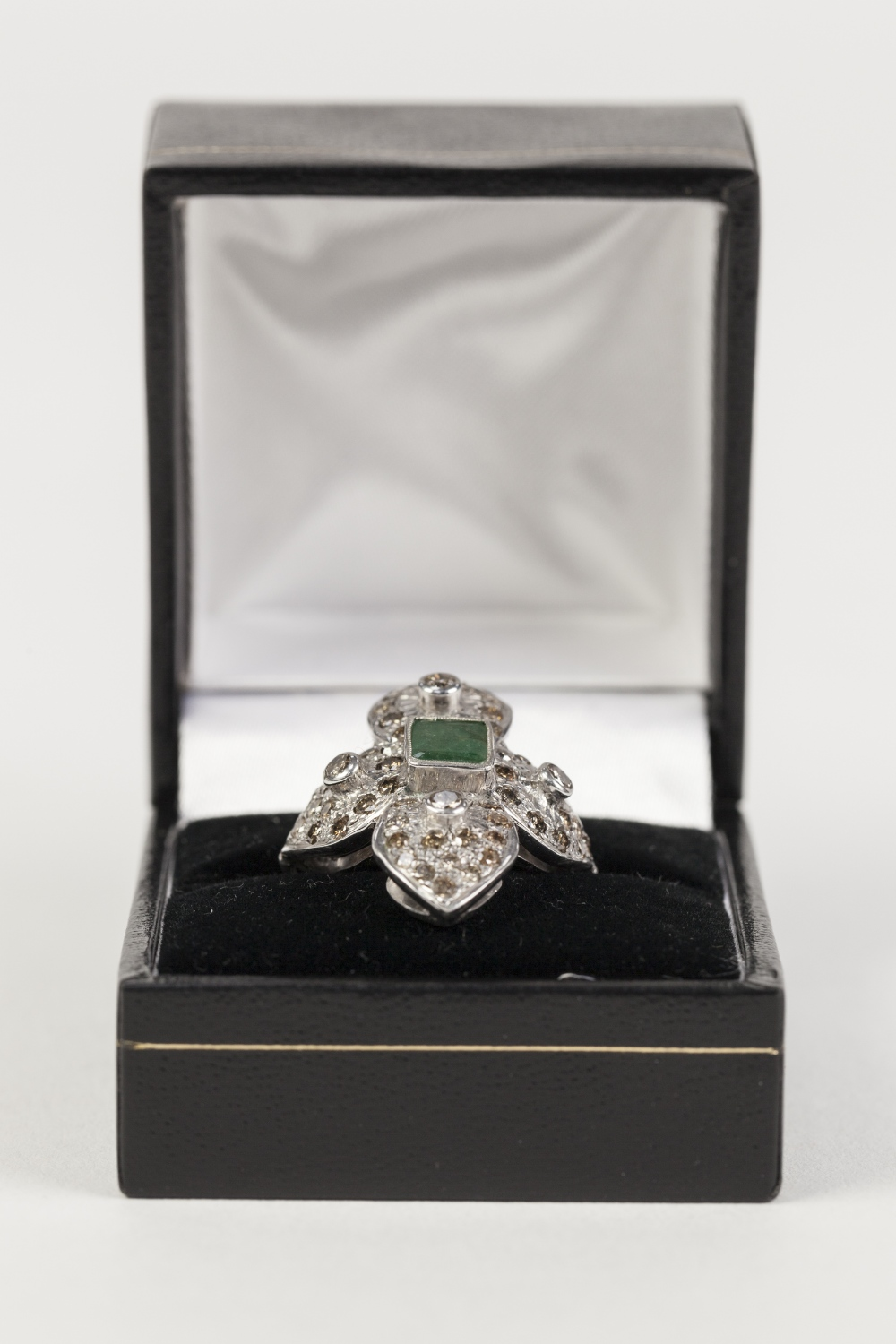 Lot 181 - WHITE GOLD COLOURED METAL RING (unmarked) with centre collet set oblong emerald, the surround of