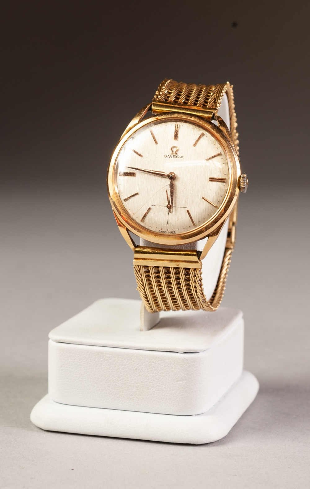 Lot 7 - OMEGA 18ct GOLD CASED GENTLEMAN'S WRISTWATCH on 18ct gold woven bracelet, 57 gms gross