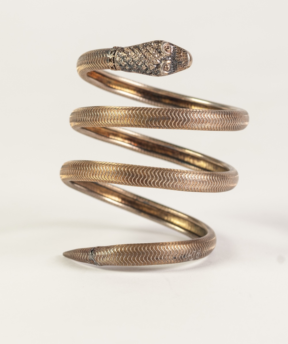 Lot 63 - VICTORIAN GOLD COLOURED METAL COILED SPRING SHAPED SNAKE BANGLE, scale pattern surface, 41gms (tests