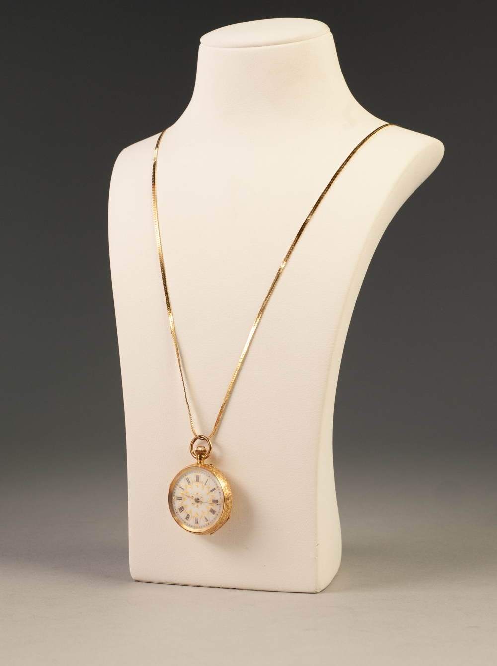 Lot 35 - LADY'S 18ct GOLD POCKET WATCH, with keyless movement, gilt decorated porcelain Roman dial, the