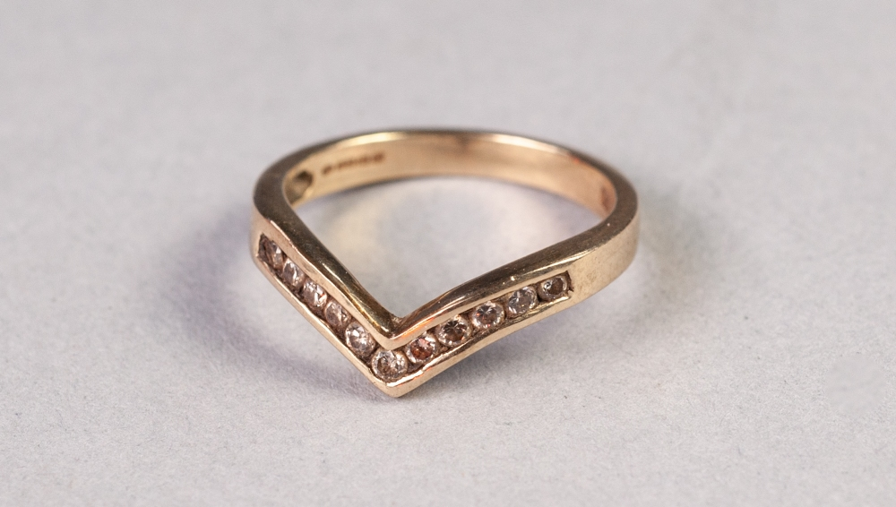 Lot 156 - 9ct GOLD RING, the 'V' shaped top channel set with eleven tiny diamonds, 2.2 gms, ring size L