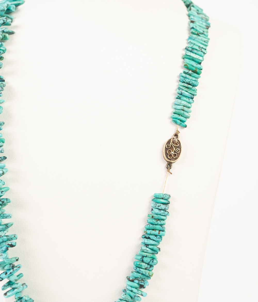 "Lot 99 - 'BRANCH' TURQUOISE BEAD NECKLACE, the silver oval clasp, 23"" long"
