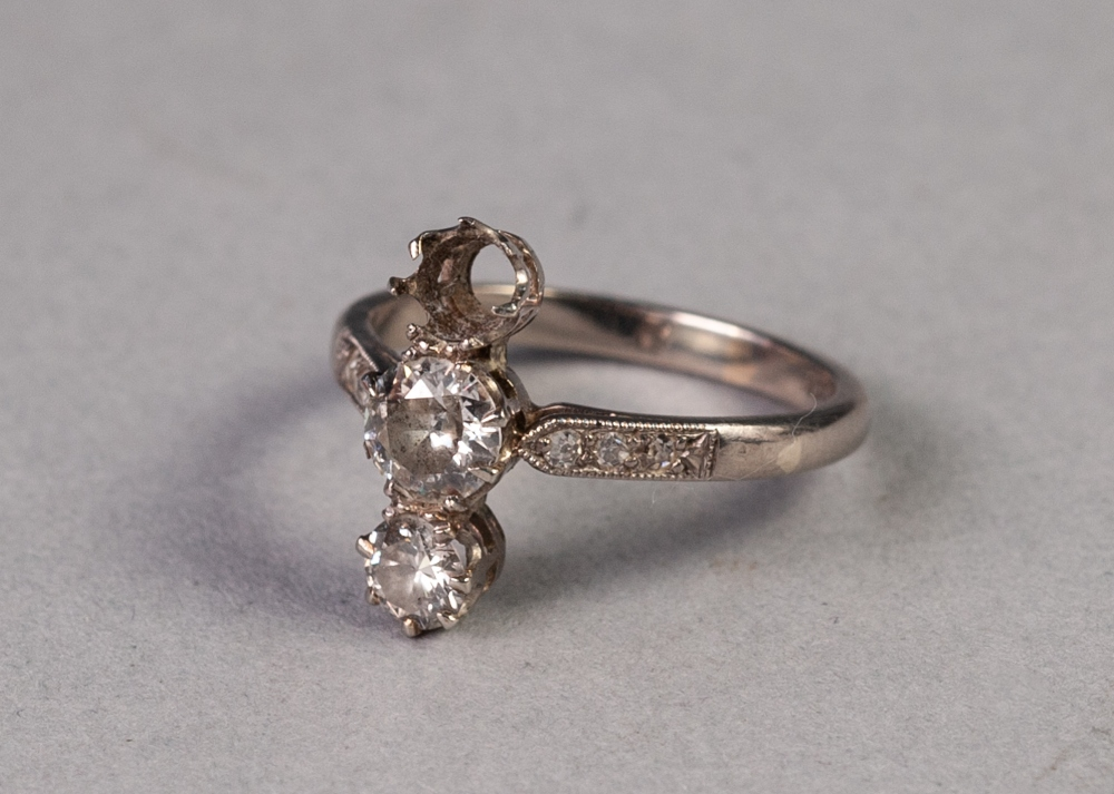 Lot 78 - 18ct GOLD AND DIAMOND RING, cross set with two diamonds and one vacant setting, the centre diamond
