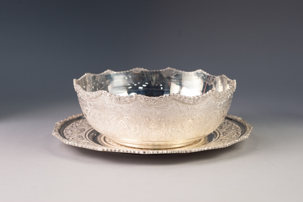 Lot 219 - MODERN, PROBABLY IRANIAN, SOFT SILVER COLOURED METAL BOWL ON STAND, each decorated win the