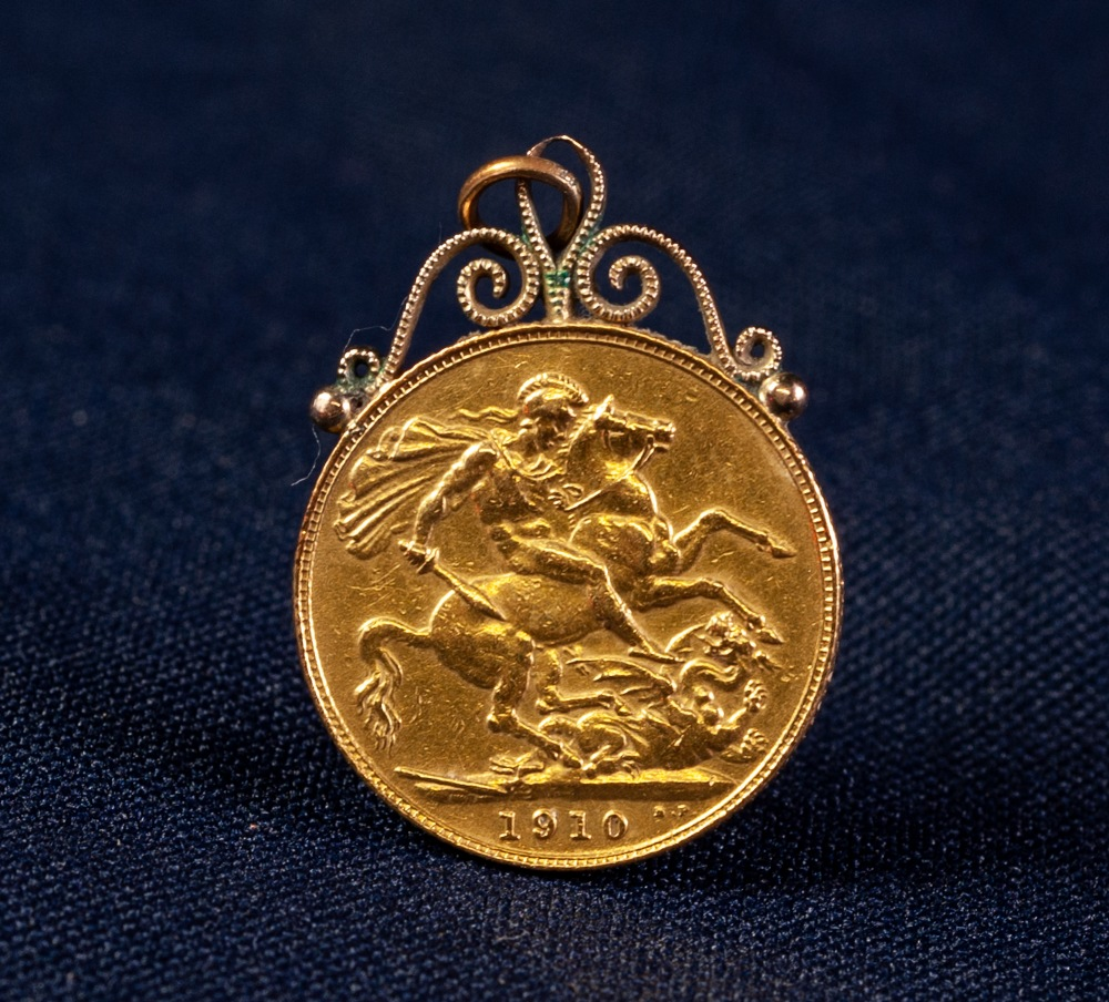 Lot 42 - EDWARD VII (1910) GOLD SOVEREIGN with soldered suspension loop