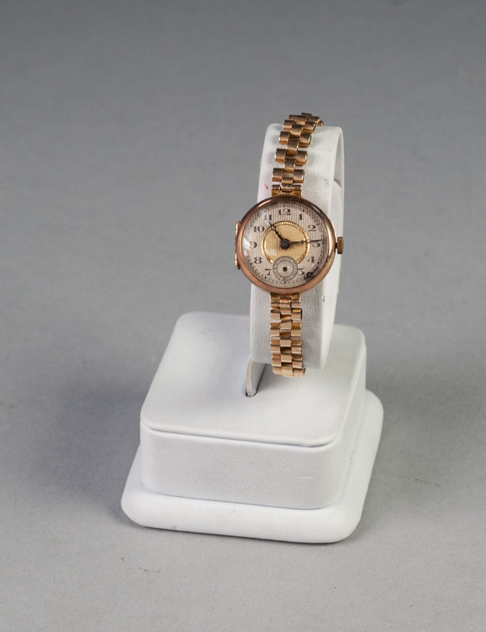 Lot 15 - a 9ct GOLD LADY'S WRIST WATCH, on rolled gold linked bracelet (seconds hand detached)