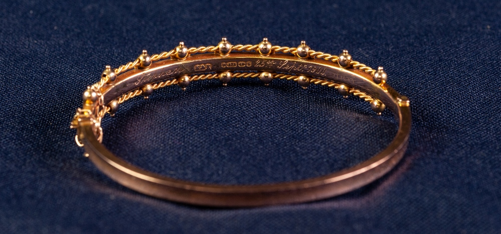 Lot 146 - CASED LATE VICTORIAN 9ct GOLD TINY TURQUOISE AND SEED PEARL SET STIFF BANGLE, engraved to the inside