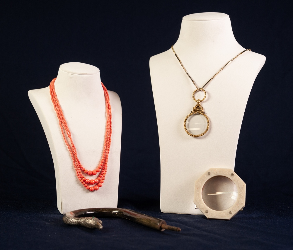TRIPLE STRAND CORAL NECKLACE together with a PINCHBECK MOUNTED EYE GLASS suspended from a GILT METAL