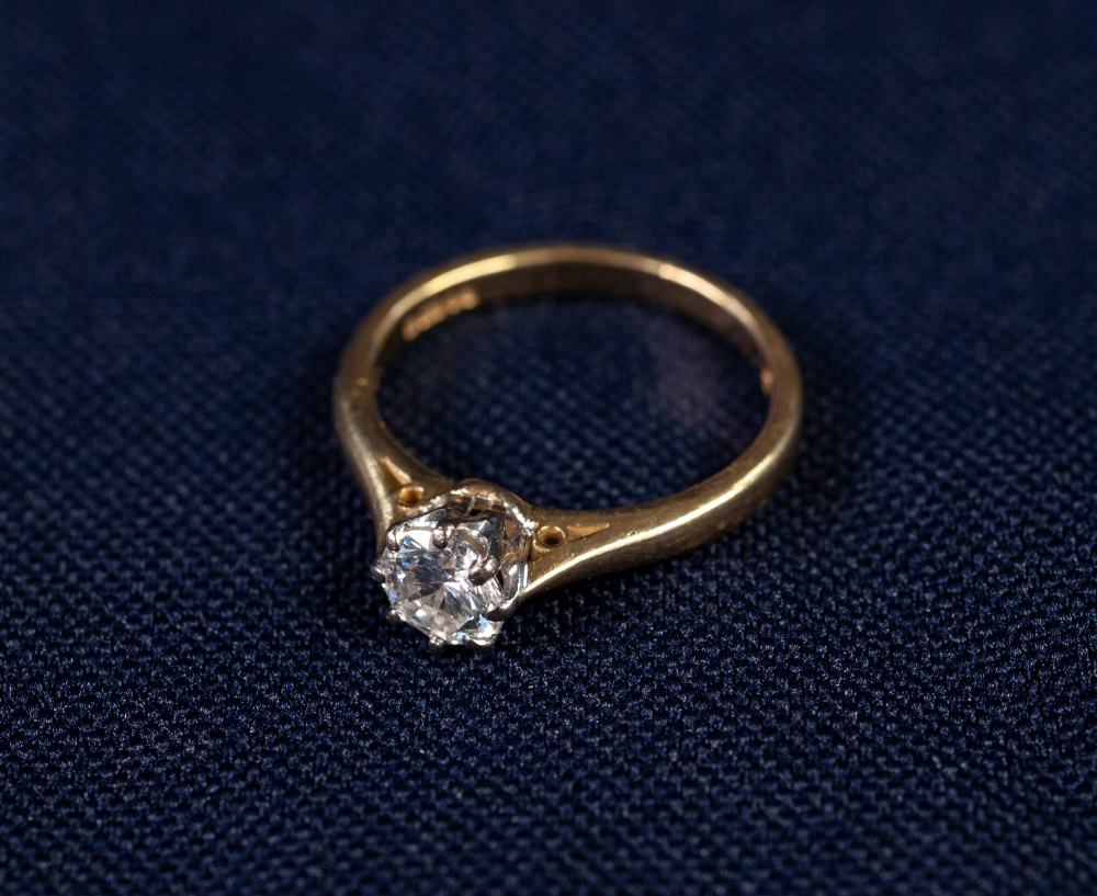 Lot 172 - 18ct GOLD RING, with a round brilliant cut solitaire diamond, approx .53ct in an eight claw