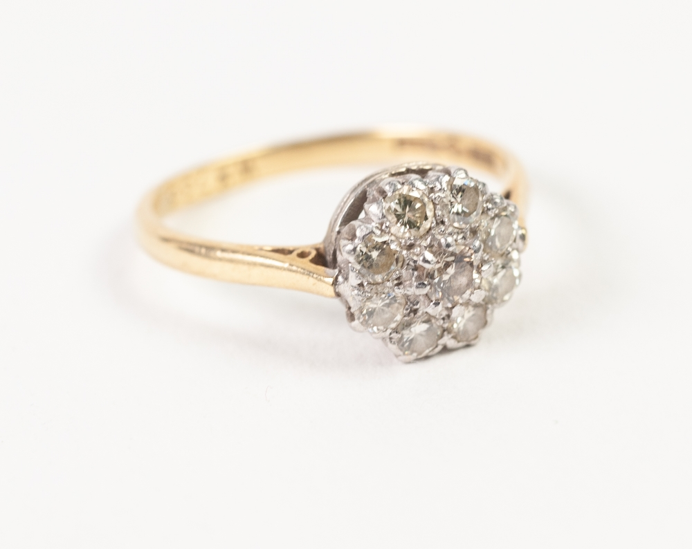 18ct GOLD, PLATINUM AND DIAMOND DAISY CLUSTER RING set with 9 brilliant cut diamonds, approx .60ct