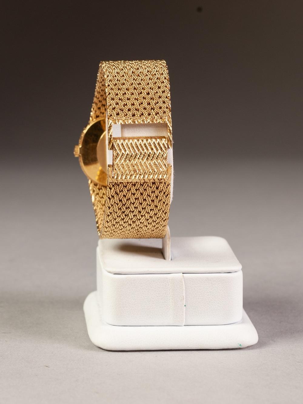 Lot 6 - BUECHE-GIROD 18CT GOLD CASED GENTLEMAN'S WRISTWATCH on integral braided bracelet, hallmarked