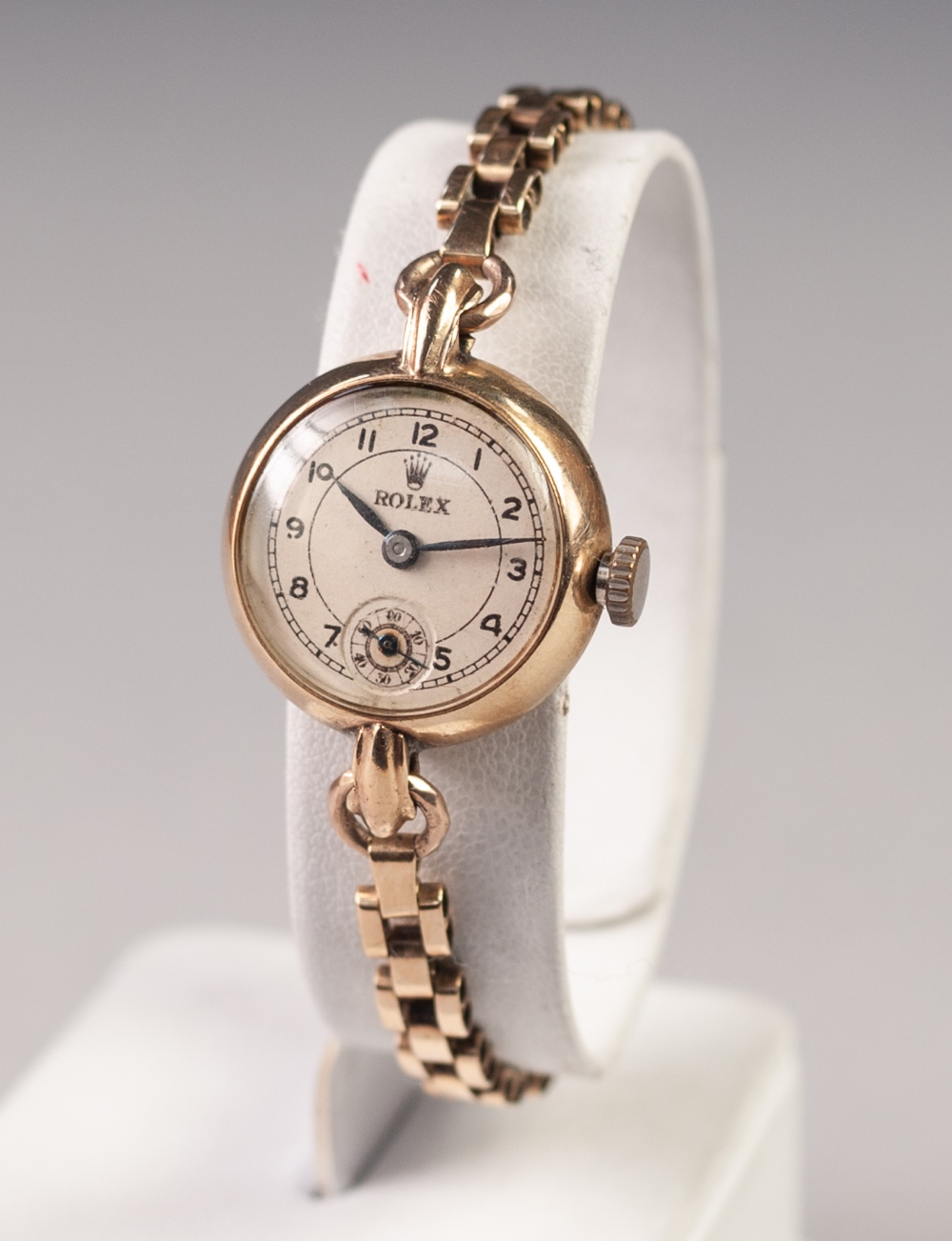 Lot 22 - LADY'S ROLEX SWISS GOLD WRIST WATCH, with mechanical movement, small circular Arabic dial with