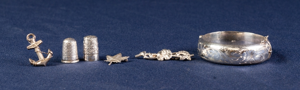Lot 126 - MODERN SILVER STIFF BANGLE, TWO SILVER THIMBLES and THREE SILVER AND WHITE METAL anchor, maple