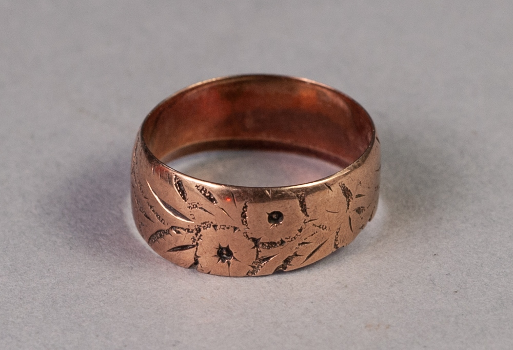 Lot 76 - 9ct GOLD BROAD BAND RING engraved with flowers, 2.7 gms, ring size J/K