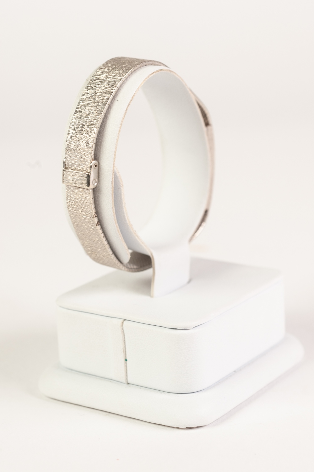 Lot 16 - 9ct WHITE GOLD LADY'S BUECHE-GIROD WRIST WATCH, the tiny square dial within uniformly textured