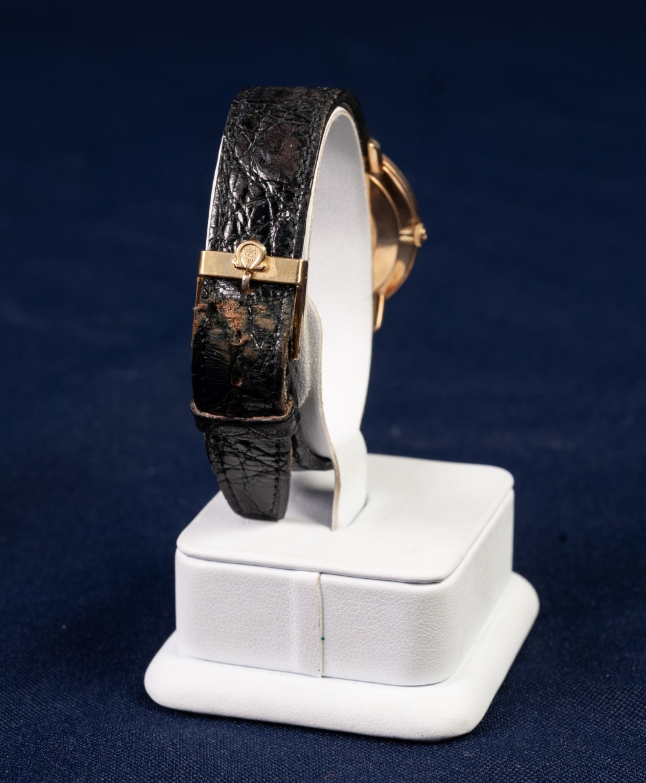 Lot 4 - A GENTS OMEGA De VILLE GOLD SWISS WRIST WATCH, with mechanical movement, circular pale gold coloured