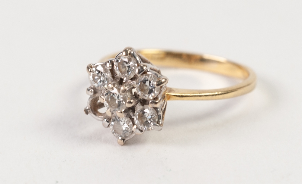 Lot 123 - 18ct GOLD AND DIAMOND DAISY CLUSTER RING, set with six (of seven) diamonds, London import mark 1990,
