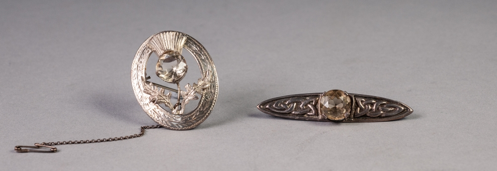 Lot 81 - SCOTTISH SILVER OVAL OPENWORK BROOCH, the thistle centre set with a Cairngorm, Edinburgh 1962 and