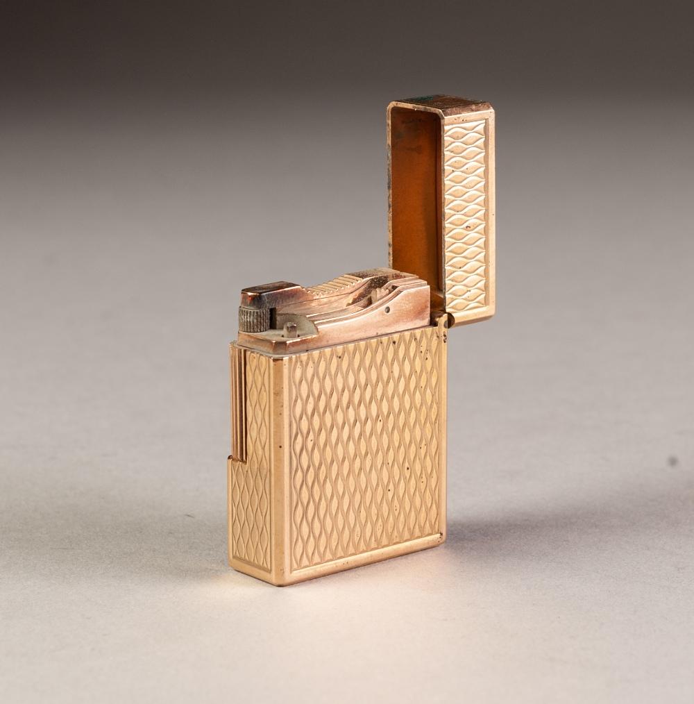 Lot 50 - DUPONT (PARIS) GOLD PLATED LADY'S CIGARETTE LIGHTER