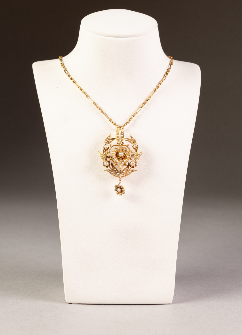 Lot 134 - EDWARDIAN GOLD COLOURED METAL SEED PEARL SET OPENWORK PENDANT AND 9ct GOLD CHAIN, 14.3 gms gross, in