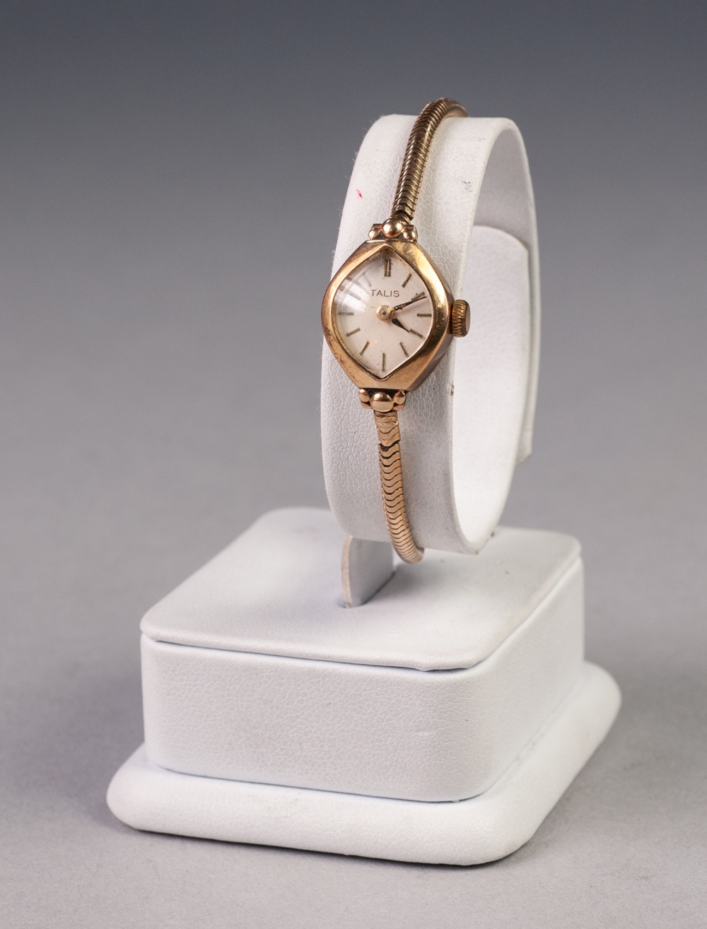 Lot 18 - LADY'S 'TALIS' 9ct GOLD WRIST WATCH, with mechanical movement, lozenge shaped silver dial with