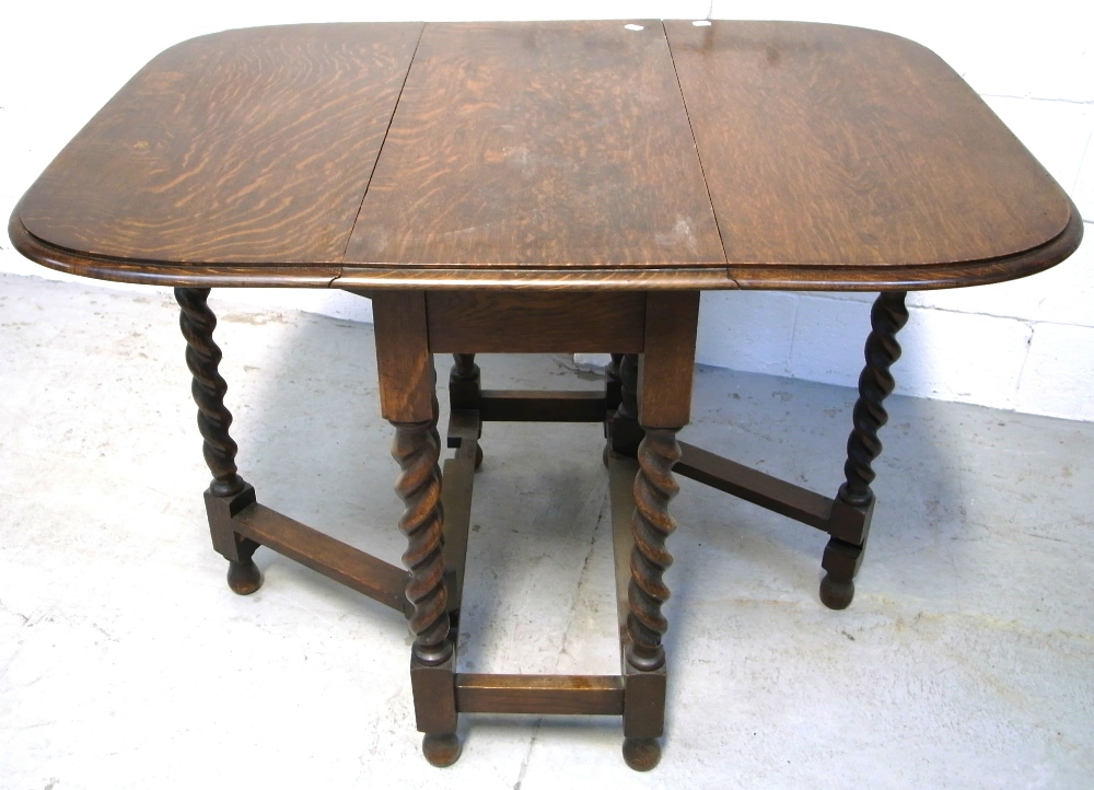 A mid 20th century oak drop leaf gate leg dining table on for Dining table support