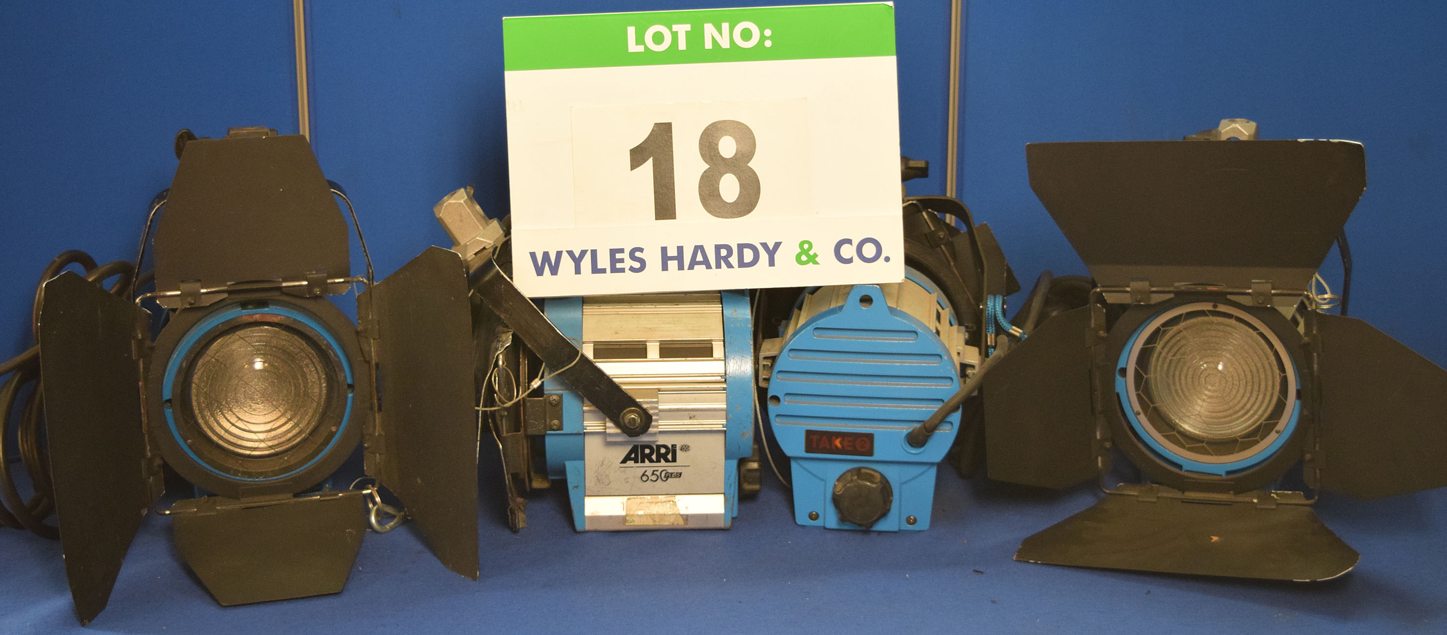 Lot 18 - Four ARRI 650 Plus 650W Lights each with fitted Barn Doors, Stirrup Mount and Switched Power Feed
