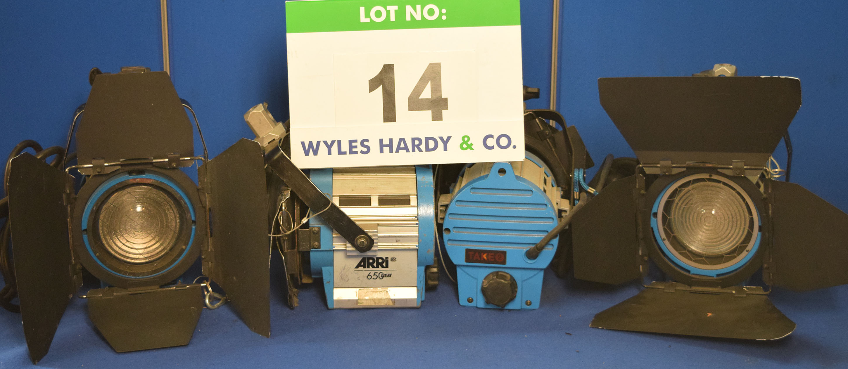 Lot 14 - Four ARRI 650 Plus 650W Lights each with fitted Barn Doors, Stirrup Mount and Switched Power Feed