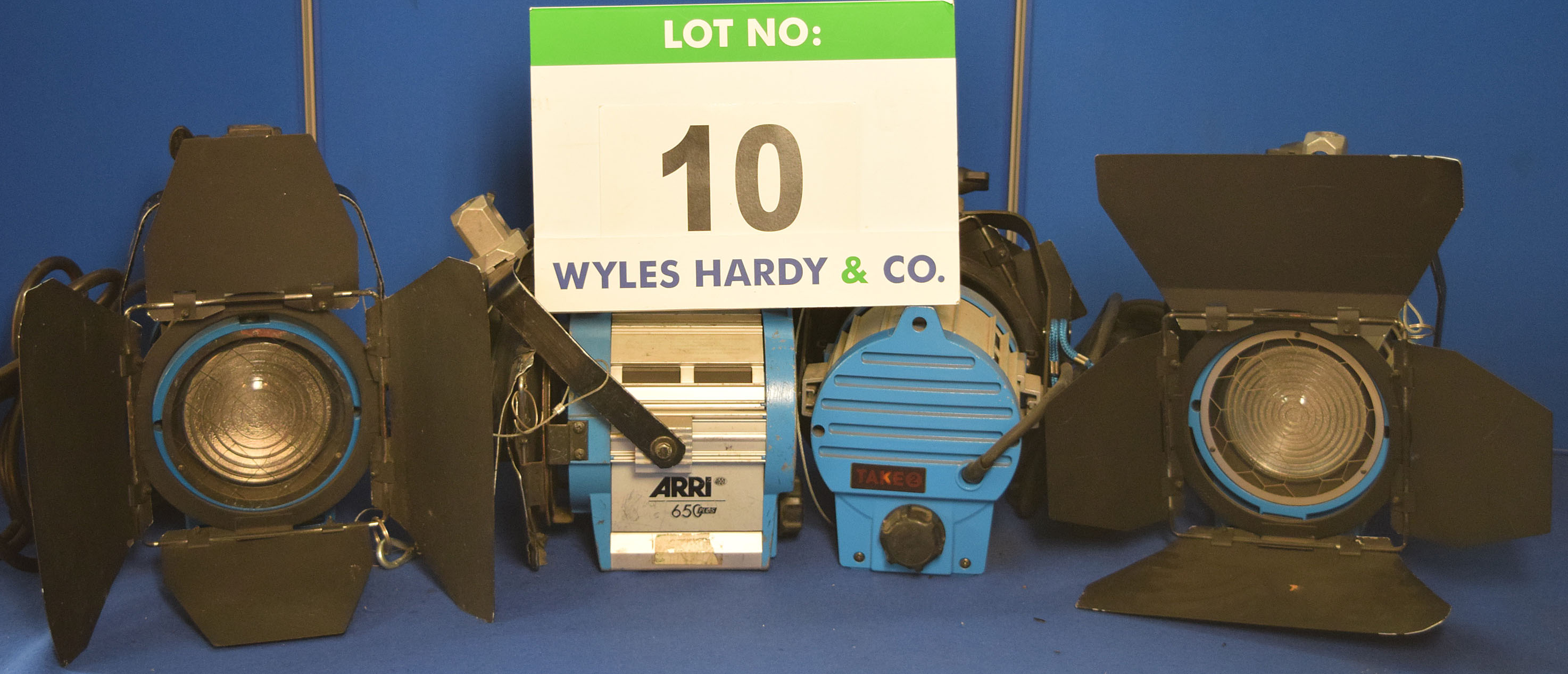 Lot 10 - Four ARRI 650 Plus 650W Lights each with fitted Barn Doors, Stirrup Mount and Switched Power Feed