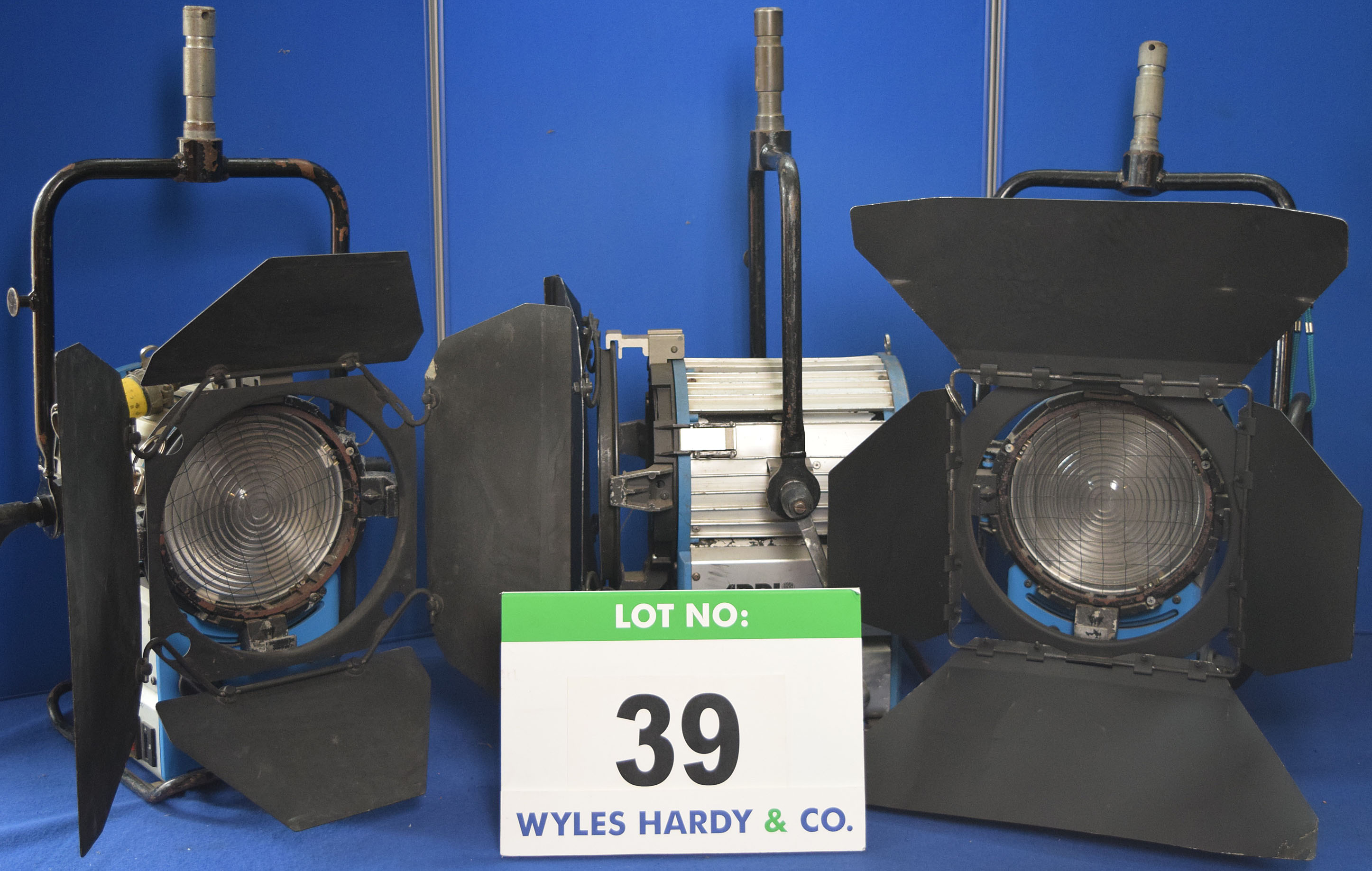 Lot 39 - Three ARRI Daylight Compact 1200 1200W Lights each with fitted Barn Door and Stirrup Mount. Recorded