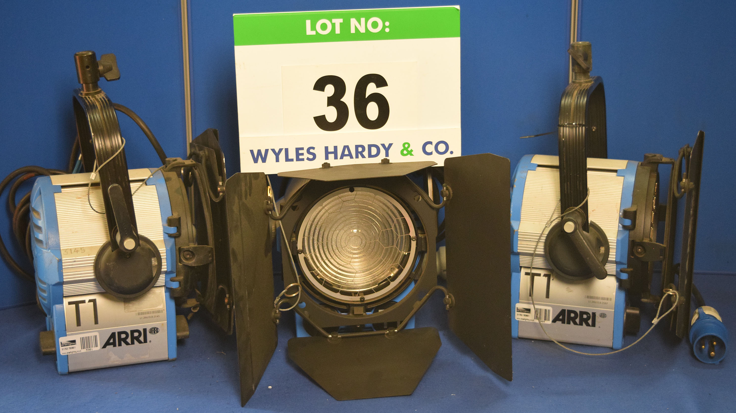 Lot 36 - Three ARRI T1 1000W Lights, Two with fitted Barn Doors and All with Stirrup Mounts and Switched