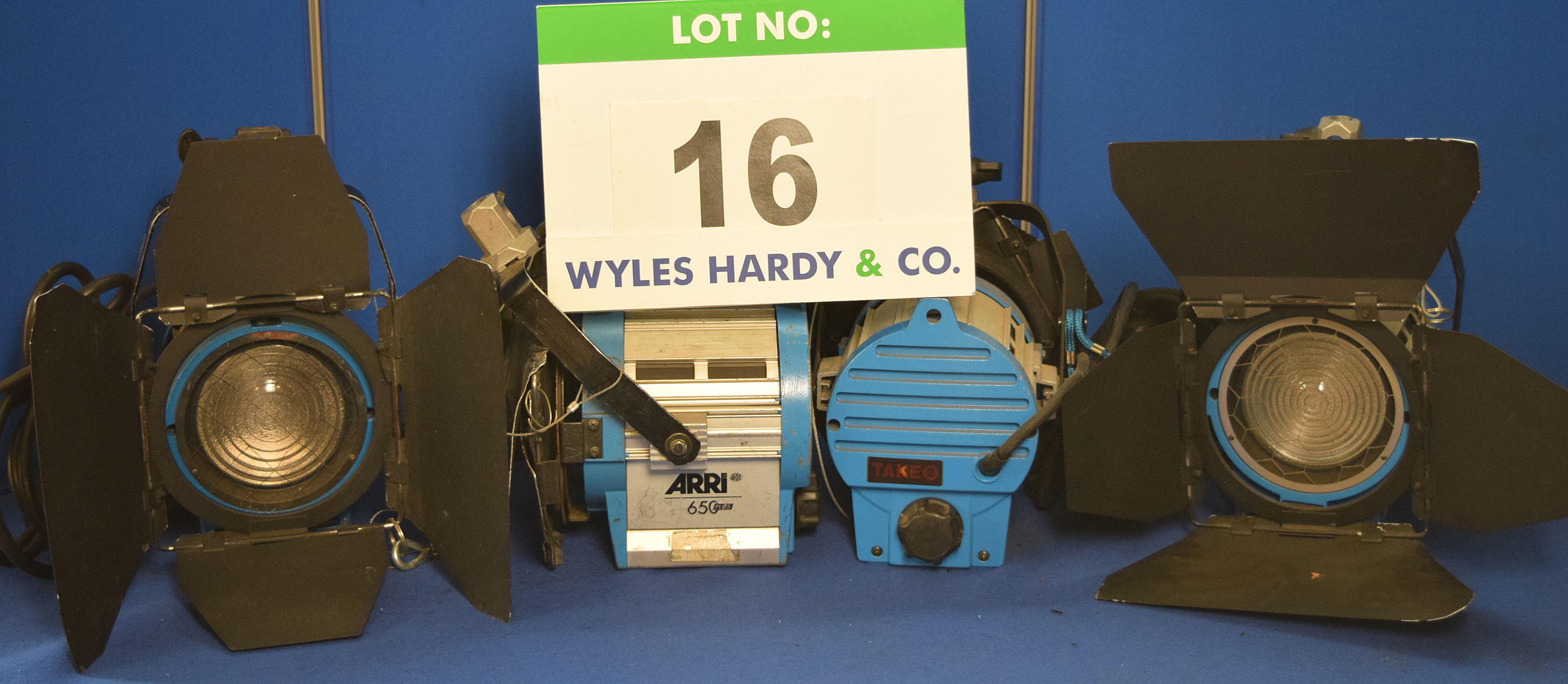 Lot 16 - Four ARRI 650 Plus 650W Lights each with fitted Barn Doors, Stirrup Mount and Switched Power Feed