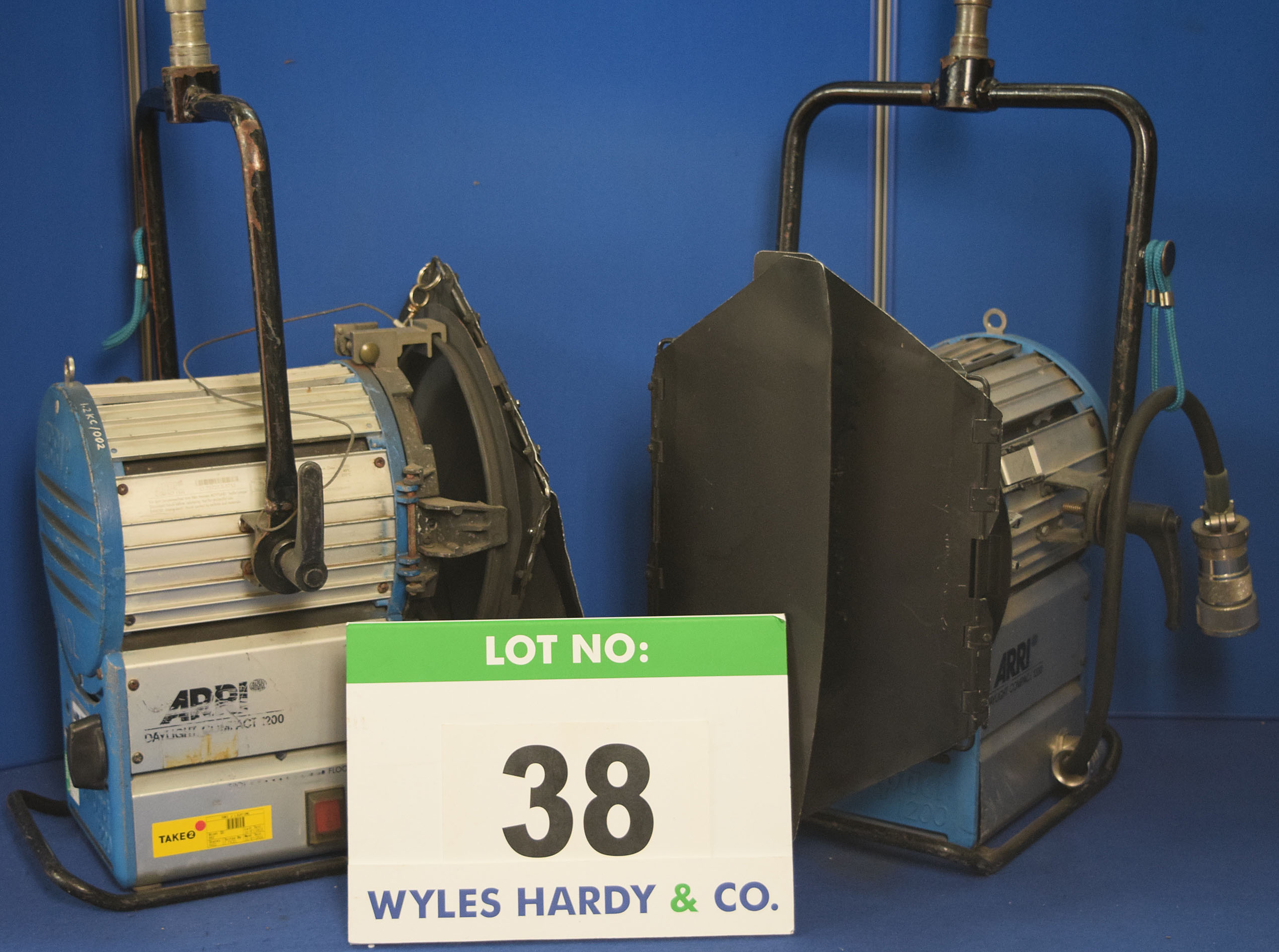 Lot 38 - Two ARRI Daylight Compact 1200 1200W Lights each with fitted Barn Door and Stirrup Mount. Recorded