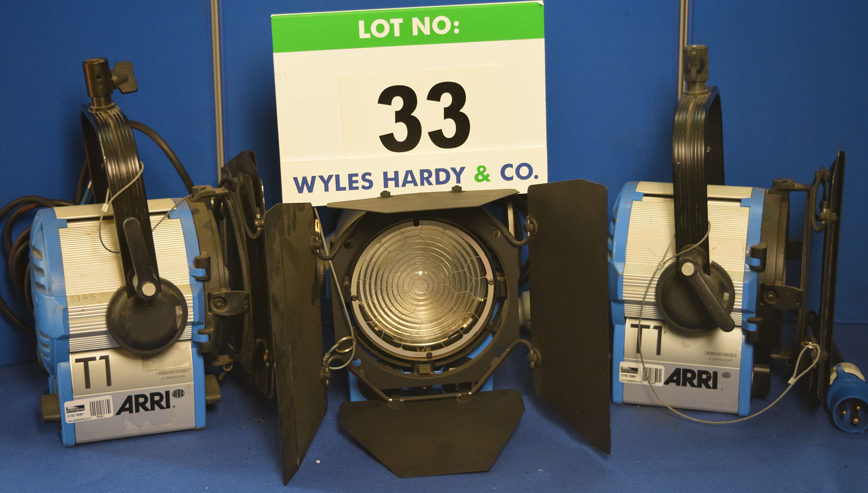 Lot 33 - Three ARRI T1 1000W Lights each with fitted Barn Doors, Stirrup Mount and Switched Power Feed