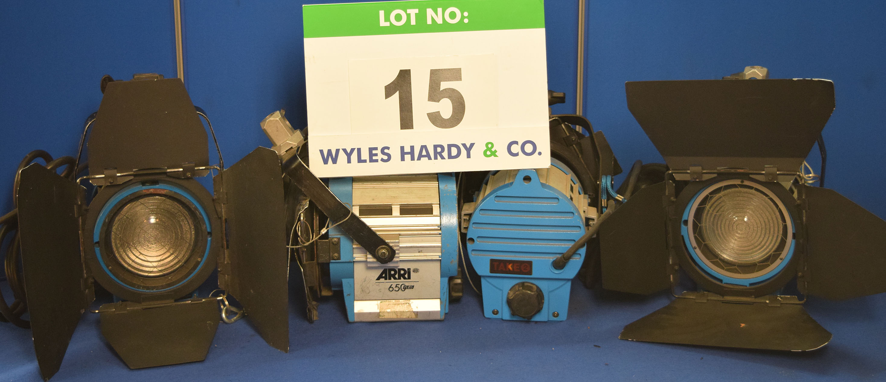 Lot 15 - Four ARRI 650 Plus 650W Lights each with fitted Barn Doors, Stirrup Mount and Switched Power Feed