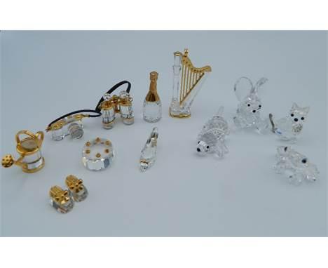 A collection of Swarovski glass models.