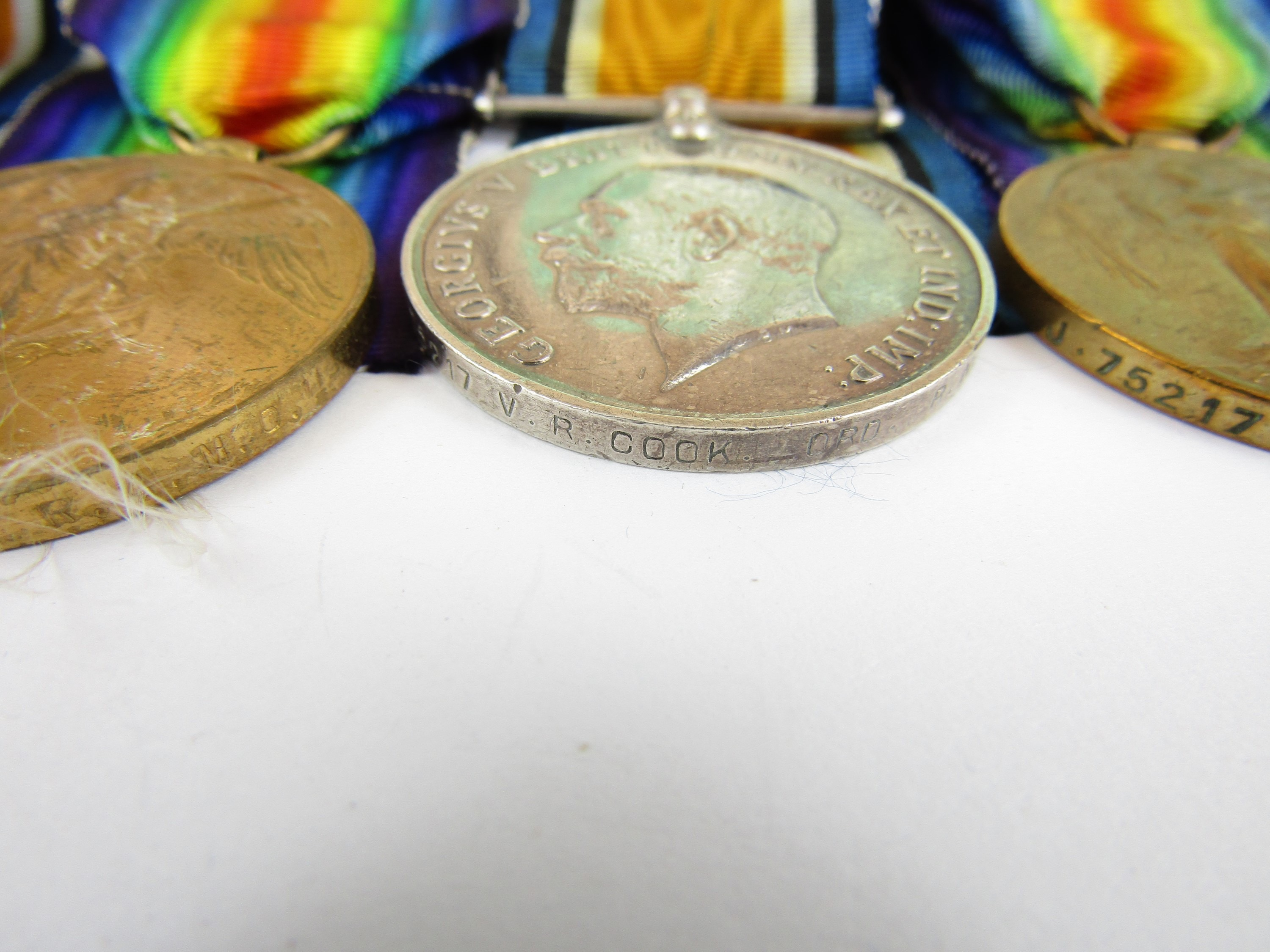 Lot 18 - British War and Victory Medal pairs respectively to J75217 V R Cook, RN and 110723 A Cpl W