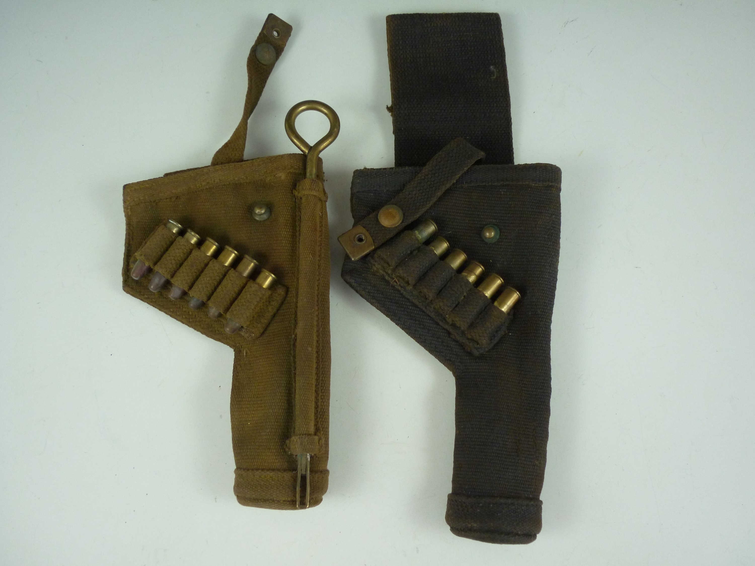 Lot 59 - Two Second World War Royal Armoured Corps webbing revolver holsters