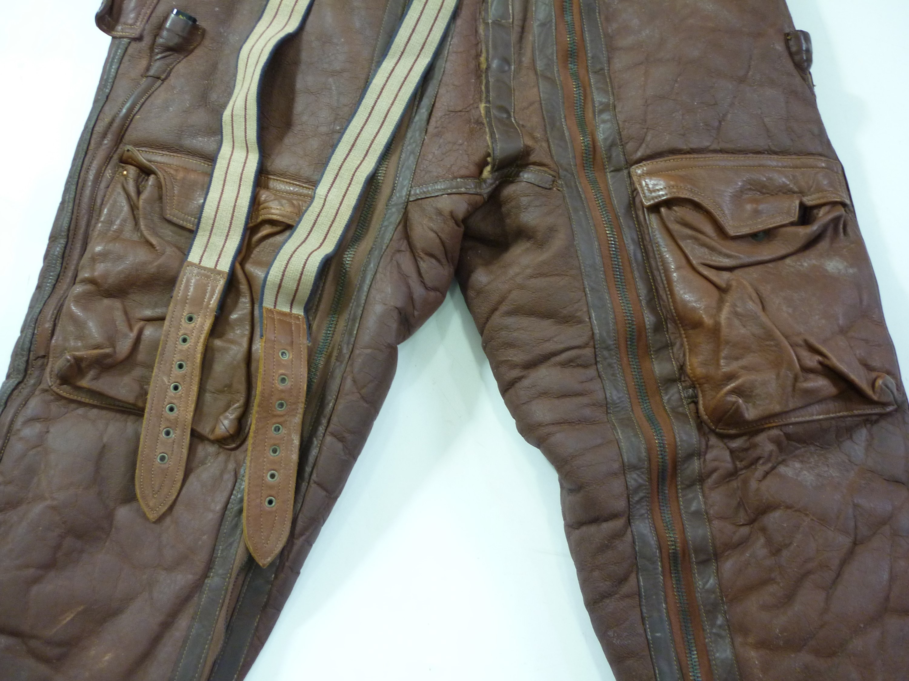 Lot 54 - A pair of Second World War RAF Irvin electrically-wired sheepskin flying trousers, Air Ministry