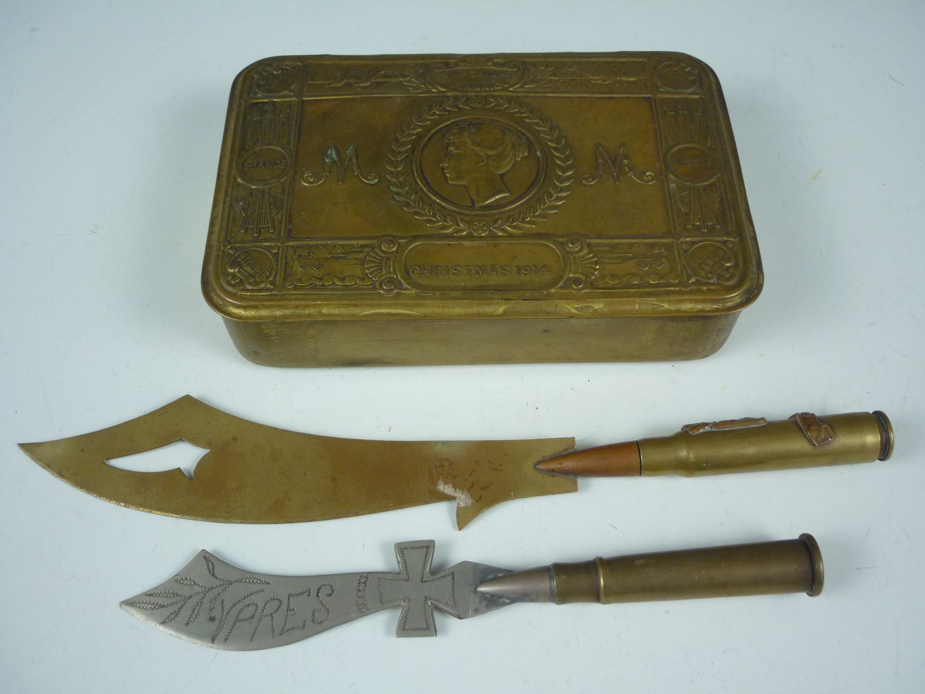 Lot 60 - A 1914 Princess Mary gift tin and two trench art letter knives