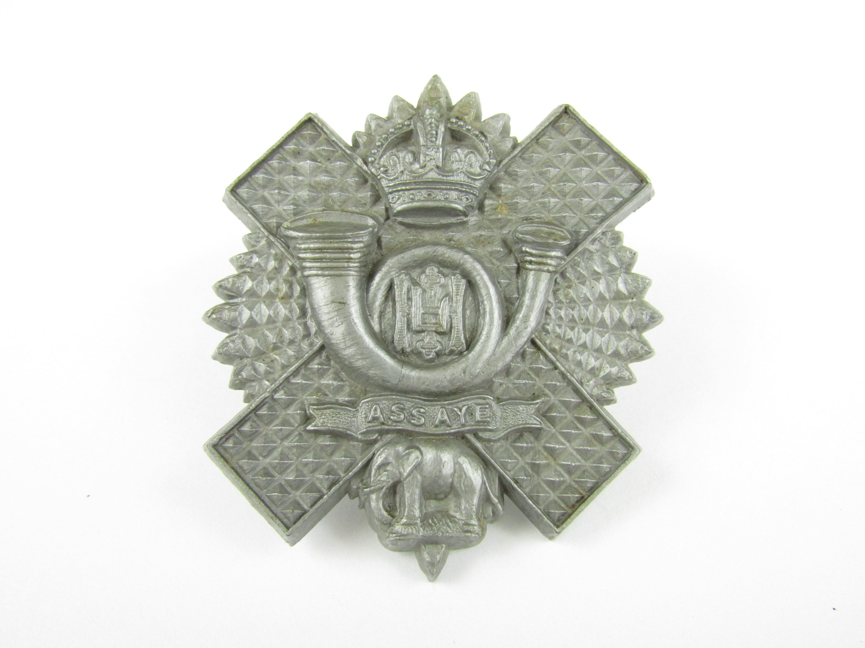 Lot 25 - A Highland Light Infantry plastic cap badge