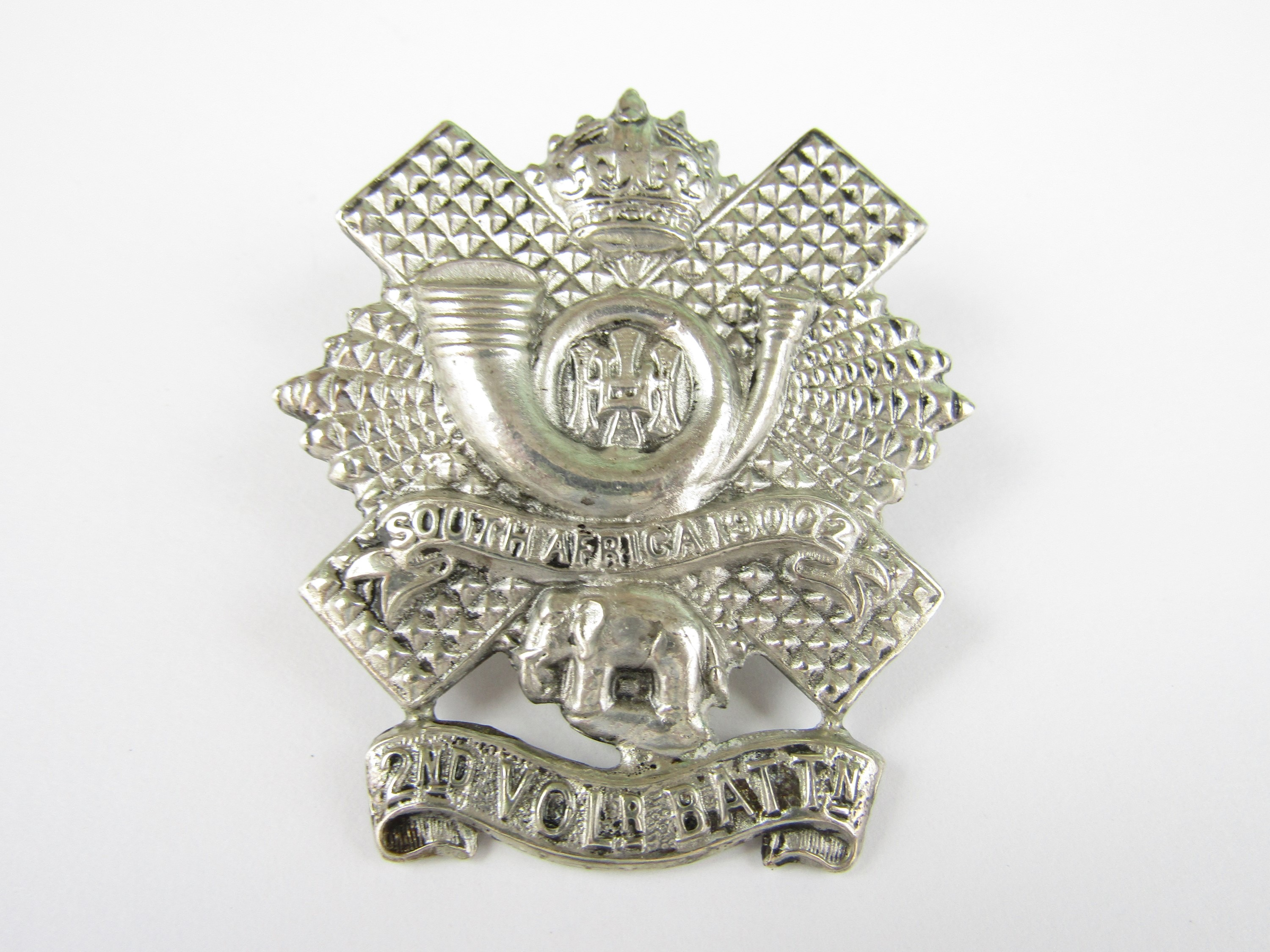 Lot 28 - A 2nd Volunteer Battalion HLI piper's or officer's cap badge, stamped SILVER and bearing the