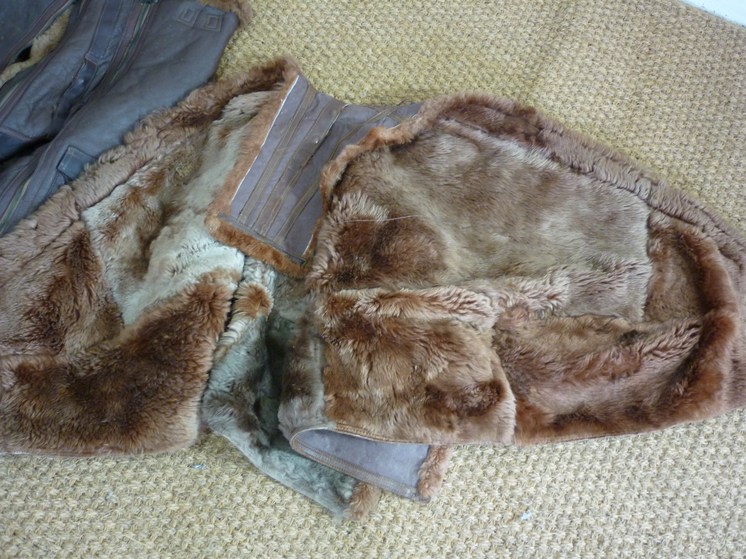 Lot 53 - A pair of Second World War RAF Irvin sheepskin flying trousers, (one zip a/f), together with another