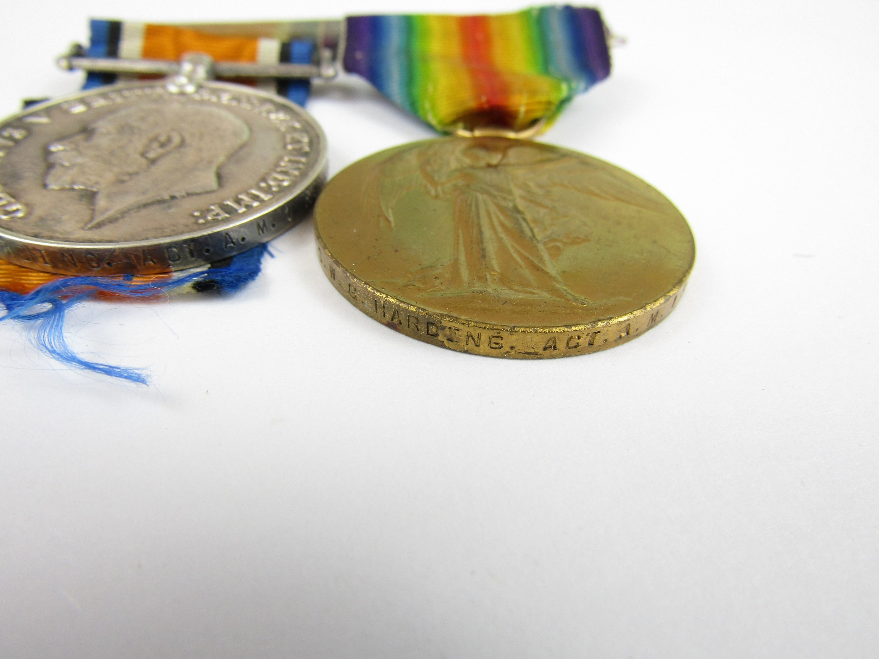 Lot 15 - A British War and Victory Medal pair to F6726 G W G Harding, Act AM I, RNAS